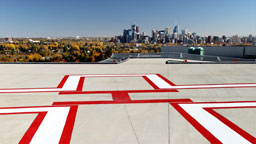 <strong>All about what you can't see...</strong></br>                     This is the new helicopter pad on the roof of the Foothills Hospital.   It is also the only shot where the client's product is clearly visible, the self leveling compound which makes up the entire surface of the landing area.